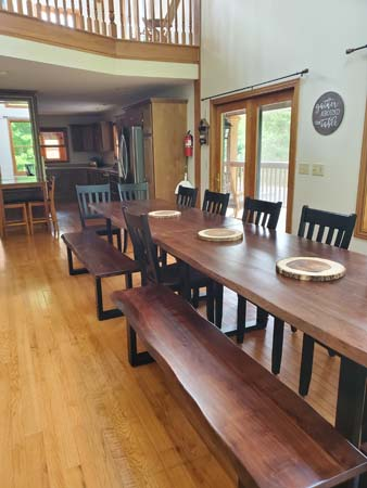Long dining table with bench and chair seating