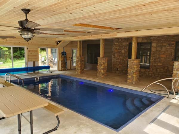 Indoor heated saltwater pool. Pool house with picnic style seating.